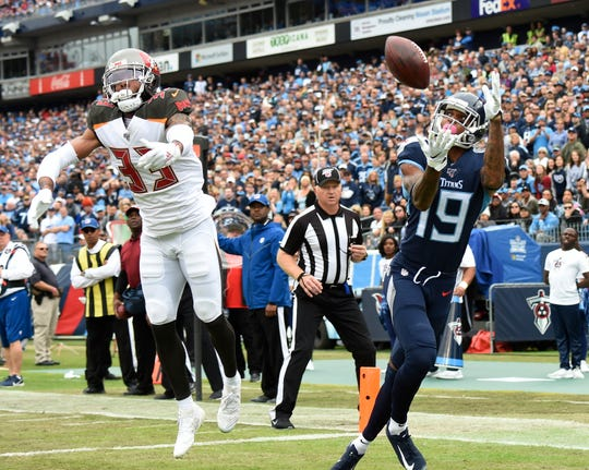 Tennessee Titans wide receiver Tajae Sharpe (19) makes a touchdown catch in front of Tampa Bay Buccaneers cornerback Carlton Davis (33) in the first quarter at Nissan Stadium Sunday, Oct. 27, 2019 in Nashville, Tenn.