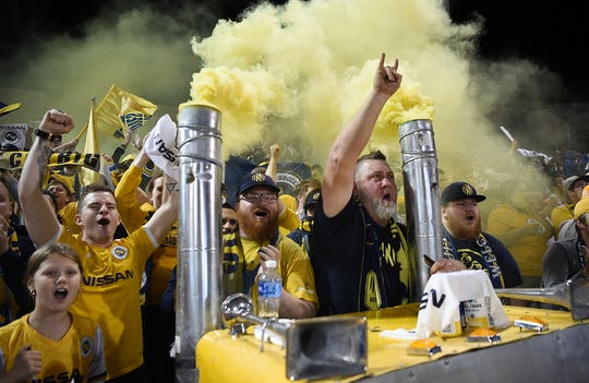 Nashville SC fans cheer the team's Eastern Conference quarterfinal win over Charleston Battery SC on Oct. 26.