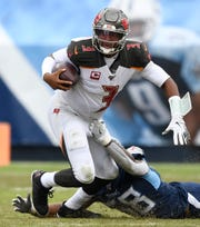 Tennessee Titans linebacker Harold Landry (58) pulls down Tampa Bay Buccaneers quarterback Jameis Winston (3) during the fourth quarter at Nissan Stadium Sunday, Oct. 27, 2019 in Nashville, Tenn.