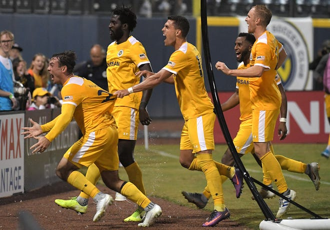 Nashville SC players celebrate after  Derrick Jones (4) scores against Charleston Battery in the second half during Eastern Conference Quarterfinal match at First Tennessee Park in Nashville on Saturday, Oct. 26, 2019.