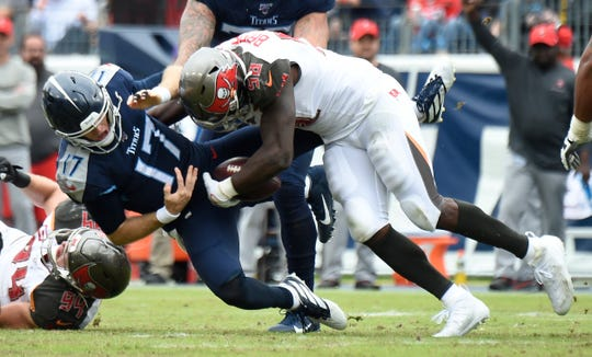Tennessee Titans quarterback Ryan Tannehill is sacked and fumbles against Tampa Bay on Oct. 27. The Titans have allowed a league-high 34 sacks so far this season.