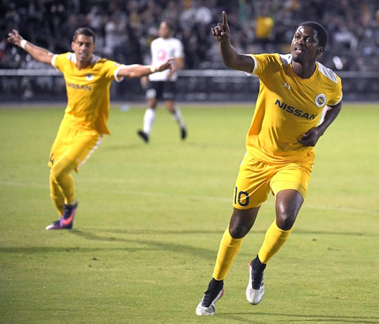 Nashville SC midfielder Lebo Moloto (10) celebrates after scoring against Charleston Battery in the first half during the Eastern Conference quarterfinal match at First Tennessee Park in Nashville on Oct. 26, 2019.