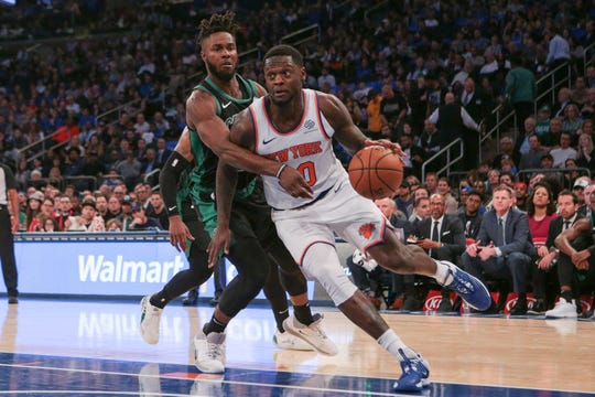 Oct 26, 2019; New York, NY, USA; New York Knicks center Julius Randle (30) drives to the basket as Boston Celtics forward Semi Ojeleye (37) defends during the first half at Madison Square Garden.