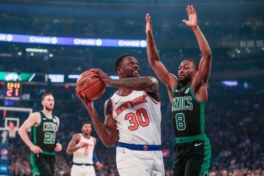 Oct 26, 2019; New York, NY, USA; New York Knicks center Julius Randle (30) drives to the basket as Boston Celtics guard Kemba Walker (8) defends during the first quarter at Madison Square Garden.