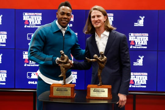 Milwaukee Brewers Josh Hader, right, and New York Yankees Aroldis Chapman pose with their reliever of the year trophies at a news conference before Game 4 of the baseball World Series between the Houston Astros and the Washington Nationals Saturday, Oct. 26, 2019, in Washington.