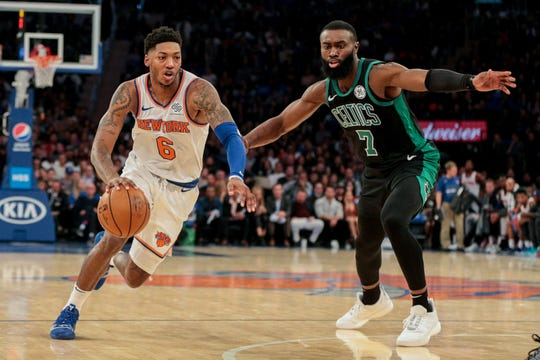 Oct 26, 2019; New York, NY, USA; New York Knicks guard Elfrid Payton (6) drives to the basket as Boston Celtics guard Jaylen Brown (7) defends during the first half at Madison Square Garden.
