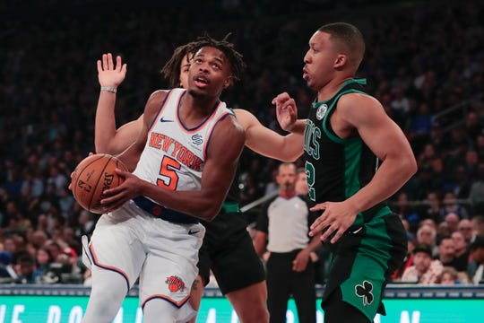 Oct 26, 2019; New York, NY, USA; New York Knicks guard Dennis Smith Jr. (5) drives to the basket as Boston Celtics forward Grant Williams (12) defends during the first half at Madison Square Garden.