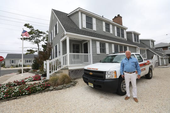 Mantoloking Office of Emergency Management Director Bob McIntyre in front of his home, that is one block from the beach and was damaged by Super Storm Sandy. Mantoloking was the hardest town hit by Super Storm Sandy in 2012.