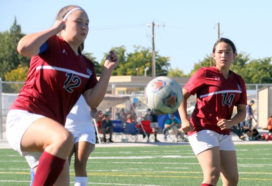Megan Wertz (12) and Lillian Renreria (14) were two busy Lady 'Cat defenders on Saturday.