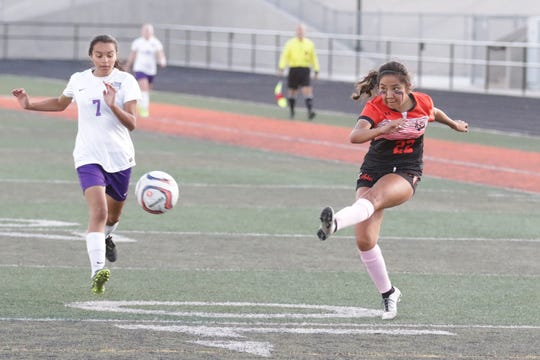 Aztec's Dionne Nelson fires a shot against Miyamura during a District 1-4A girls soccer match on Thursday, Oct. 17 at Fred Cook Memorial Stadium in Aztec.