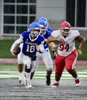 Catholic Central quarterback Jack Beno runs the ball against Orchard Lake St Mary's. Detroit Catholic Central falls to Orchard Lake St. Mary's 13-0 in the Catholic League Bishop Championship on Oct. 26 at Eastern Michigan.