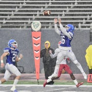 Catholic Central efensive back Jacob Young brings in an interception. Detroit Catholic Central falls to Orchard Lake St. Mary's 13-0 in the Catholic League Bishop Championship on Oct. 26 at Eastern Michigan.