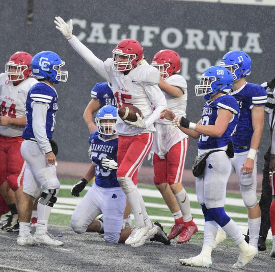 Trey Cosnowski signals Orchard Lake St. Mary's recovered a fumble against Catholic Central. Detroit Catholic Central falls to Orchard Lake St. Mary's 13-0 in the Catholic League Bishop Championship on Oct. 26 at Eastern Michigan.