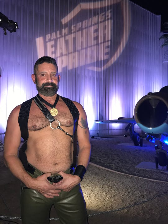 Randy Carmenaty, Palm Springs Leather Order of the Desert chairman, poses for a picture at the 25th annual Mr. Palm Springs Leather competition Saturday at the Palm Springs Air Museum.