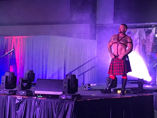 Charlie Harding, named Mr. Palm Springs Leather 2019, takes the stage during the competition Saturday night at the Palm Springs Air Museum.
