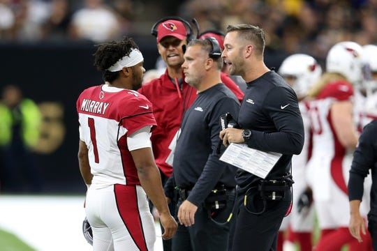 Cardinals coach Kliff Kingsbury talks to quarterback Kyler Murray (1) during the first quarter of a game against the Saints at the Mercedes-Benz Superdome.