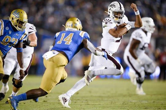 Arizona State quarterback Jayden Daniels is chased by UCLA linebacker Krys Barnes (14) during the second half of a game Oct. 26 at the Rose Bowl.