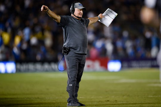 Oct 26, 2019; Pasadena, CA, USA; UCLA Bruins head coach Chip Kelly stretches during a break in play during the second half against the Arizona State Sun Devils at Rose Bowl. Mandatory Credit: Kelvin Kuo-USA TODAY Sports