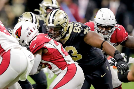 Saints defensive tackle David Onyemata (93) tackles Cardinals running back Chase Edmonds (29) for a turnover on downs during the third quarter at the Mercedes-Benz Superdome.