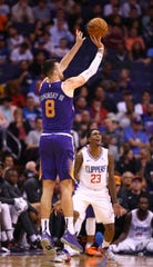 Phoenix Suns forward Frank Kaminsky (8) makes a 3-pointer against the LA Clippers in the second half on Oct. 26, 2019 in Phoenix, Ariz.