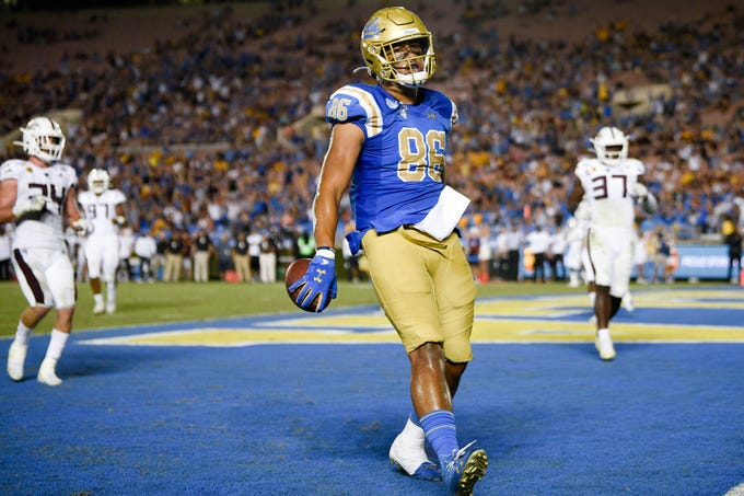 Oct 26, 2019; Pasadena, CA, USA; UCLA Bruins tight end Devin Asiasi (86) reacts after a touchdown during the second half against the Arizona State Sun Devils at Rose Bowl. Mandatory Credit: Kelvin Kuo-USA TODAY Sports