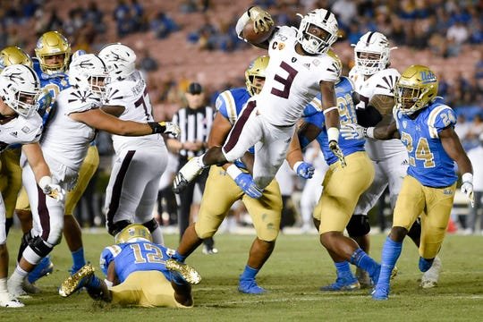 Oct 26, 2019; Pasadena, CA, USA; Arizona State Sun Devils running back Eno Benjamin (3) gets tripped by UCLA Bruins linebacker Krys Barnes (14) during the second half at Rose Bowl. Mandatory Credit: Kelvin Kuo-USA TODAY Sports