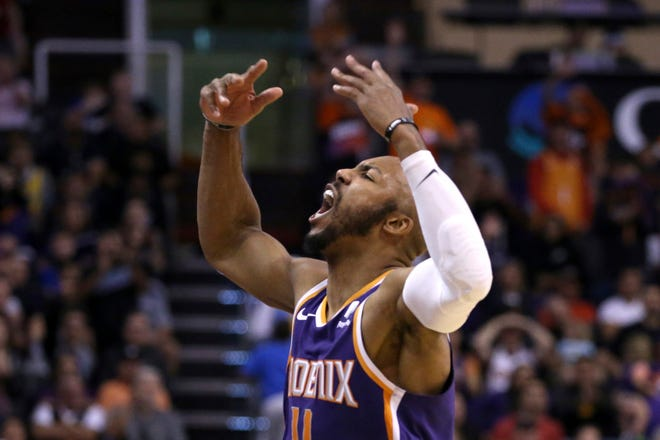 Phoenix Suns guard Jevon Carter celebrates with fans during the second half of a basketball game against the LA Clippers Saturday, Oct. 26, 2019, in Phoenix. The Suns defeated the Clippers 130-122. (AP Photo/Ross D. Franklin)