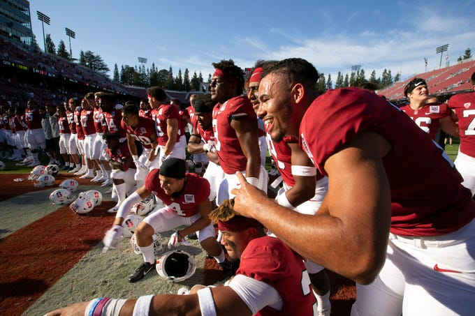 Oct 26, 2019; Stanford, CA, USA; Stanford Cardinal players celebrate their 41-31 victory over the Arizona Wildcats in an NCAA football game at Stanford Stadium. Mandatory Credit: D. Ross Cameron-USA TODAY Sports
