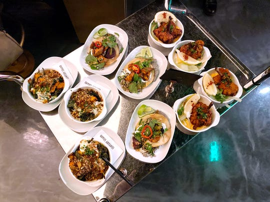 A dim sum cart loaded with dishes rolls around the main bar and dining room at Century Grand in Phoenix.