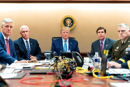 In this image released by the White House, President Donald Trump is joined by Vice President Mike Pence, second from left, national security adviser Robert O'Brien, left; Secretary of Defense Mark Esper, second from right,  and Chairman of the Joint Chiefs of Staff Army Gen. Mark A. Milley, right, Saturday, Oct. 26, 2019, in the Situation Room of the White House monitoring developments in the U.S. Special Operations forces raid that took out Islamic State leader Abu Bakr al-Baghdadi.. (Shealah Craighead/White House via AP)