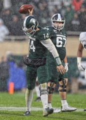 Oct 26, 2019; East Lansing, MI, USA; Michigan State Spartans quarterback Brian Lewerke (14) shows his frustration during the second half of a game against the Penn State Nittany Lions at Spartan Stadium. Mandatory Credit: Mike Carter-USA TODAY Sports