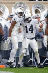 Penn State receiver KJ Hamler, left, and quarterback Sean Clifford (14) celebrate Hamler's second-quarter touchdown reception against Michigan State.