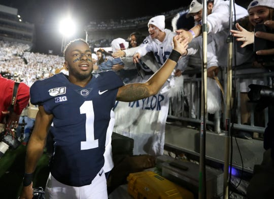 Oct 19, 2019; University Park, PA, USA; Penn State Nittany Lions wide receiver KJ Hamler (1) shakes the hands of students following the completion of the game against the Michigan Wolverines at Beaver Stadium. Penn State defeated Michigan 28-21. Mandatory Credit: Matthew O'Haren-USA TODAY Sports