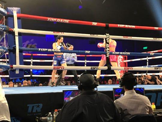 Mikaela Mayer, pink, won her fight with Alejandra Zamora
