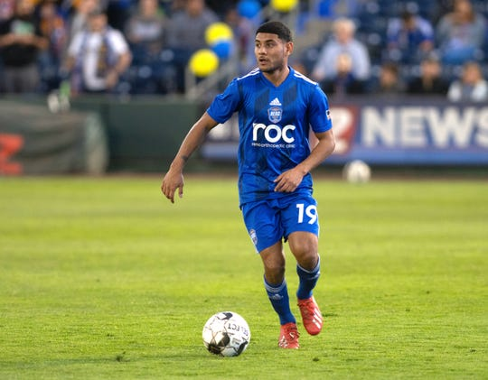 Reno 1868 FC's Kevin Partida, a former Sparks High standout, brings the ball upfield against Sacramento on Saturday night.