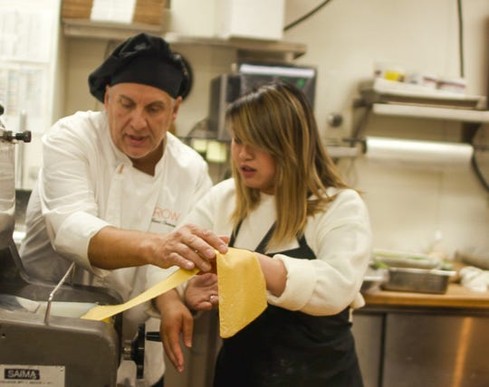 "Eldorado executive chef Ivano Centemeri assists in making pasta sheets at a recent test run for ""World of Pasta 101,"" the first of four Master Classes he's leading over the next year at the property."