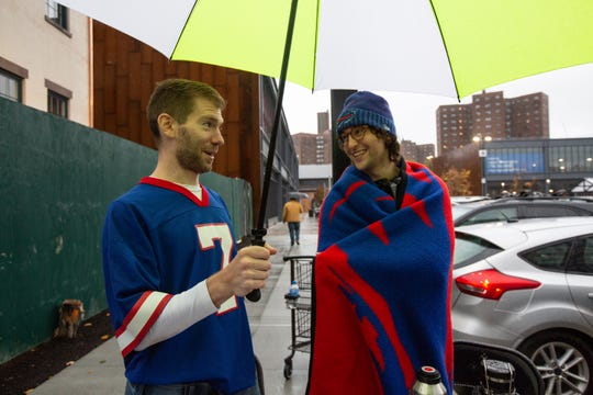Brad Orego and Jeff Pollock both are from Buffalo but now live in Brooklyn. Despite the rain, the two Buffalo Bills fans decided to tailgate for the opening of Wegmans' Brooklyn, New York, location on Sunday, Oct. 27, 2019.