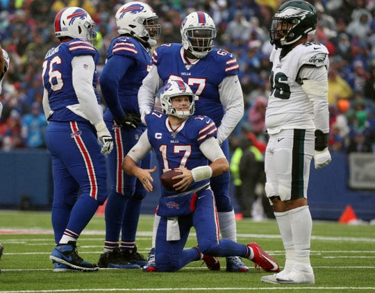 Bills quarterback Josh Allen gets to his feet after a hit by Eagles Derek Barnett.  He was pressured most of the game sacked four times.