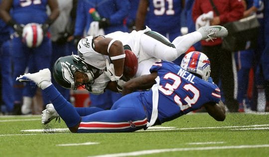 Bills Siran Neal forcers a fumble by Eagles punt returner Boston Scott.
