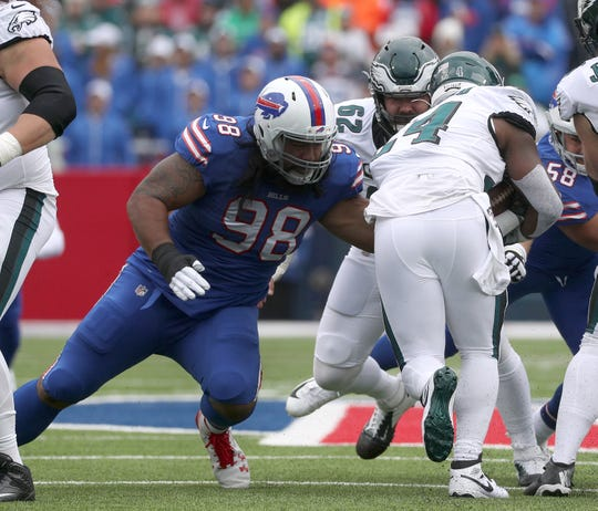 Buffalo Bills defensive tackle Star Lotulelei wraps up Eagles running back Jordan Howard.