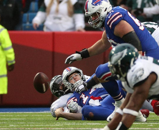 Bills quarterback Josh Allen loses the ball as his is sacked against the Eagles.