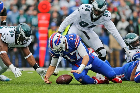 Buffalo Bills quarterback Josh Allen (17) recovers a loose ball during the first half of an NFL football game against the Philadelphia Eagles, Sunday, Oct. 27, 2019, in Orchard Park, N.Y. (AP Photo/John Munson)