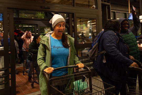 Nicole Sandretto, a self-proclaimed Wegmaniac, reacts to seeing the new Wegmans location in Brooklyn, New York. Sandretto waited for a few hours to be one of the first into the grocery store chain's Brooklyn, New York, location on Sunday, Oct. 27, 2019.