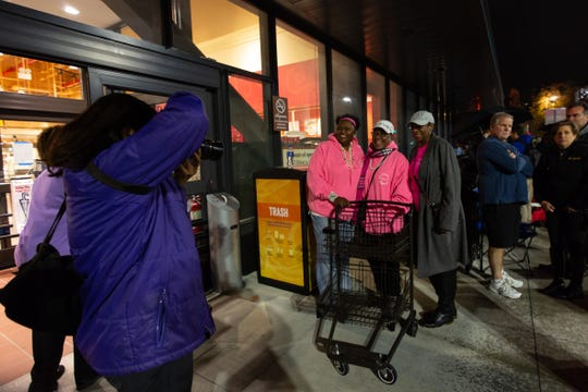 The Women of Wegmans were first in line for the opening of the grocery store chain's Brooklyn, New York, location on Sunday, Oct. 27, 2019. From left, Paula Hopson-Stanley, Susan Myers and Jill Greene pose for a photo outside of the store.