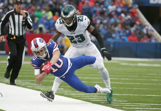 Bills receiver Cole Beasley is tackled by Eagles safety Rodney McLeod after a catch.
