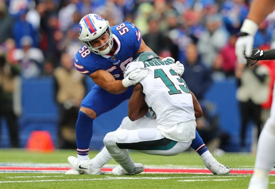 Matt Milano tackles Nelson Agholor of the Philadelphia Eagles for a loss in yards during the first half at New Era Field on October 27, 2019 in Orchard Park.