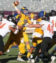 Angelo State University quarterback Payne Sullins fires a pass under pressure in a Lone Star Conference game against UT Permian Basin at LeGrand Stadium at 1st Community Credit Union Field on Saturday, Oct. 26, 2019.