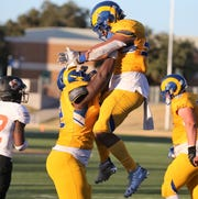 Angelo State University running back Daven Manning jumps into the arms of a teammate after scoring a touchdown against UT Permian Basin at LeGrand Stadium at 1st Community Credit Union Field on Saturday, Oct. 26, 2019.