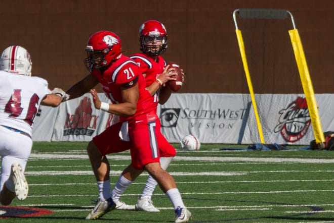 Dixie State running back D'Arman Notoa (21) blocks for his quarterback during a game last season.