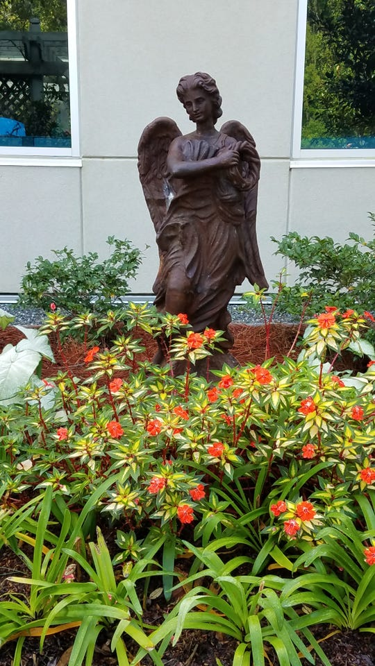 This angel stands guard over one of the beds in the Tallahassee Memorial Cancer Center Healing Garden.